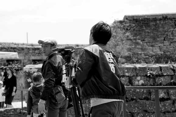 adult black and white boy cameraman